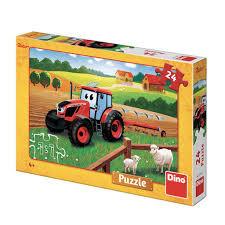 Dino puzzel 24 stukjes van een traktor met Ploeg en schapen.